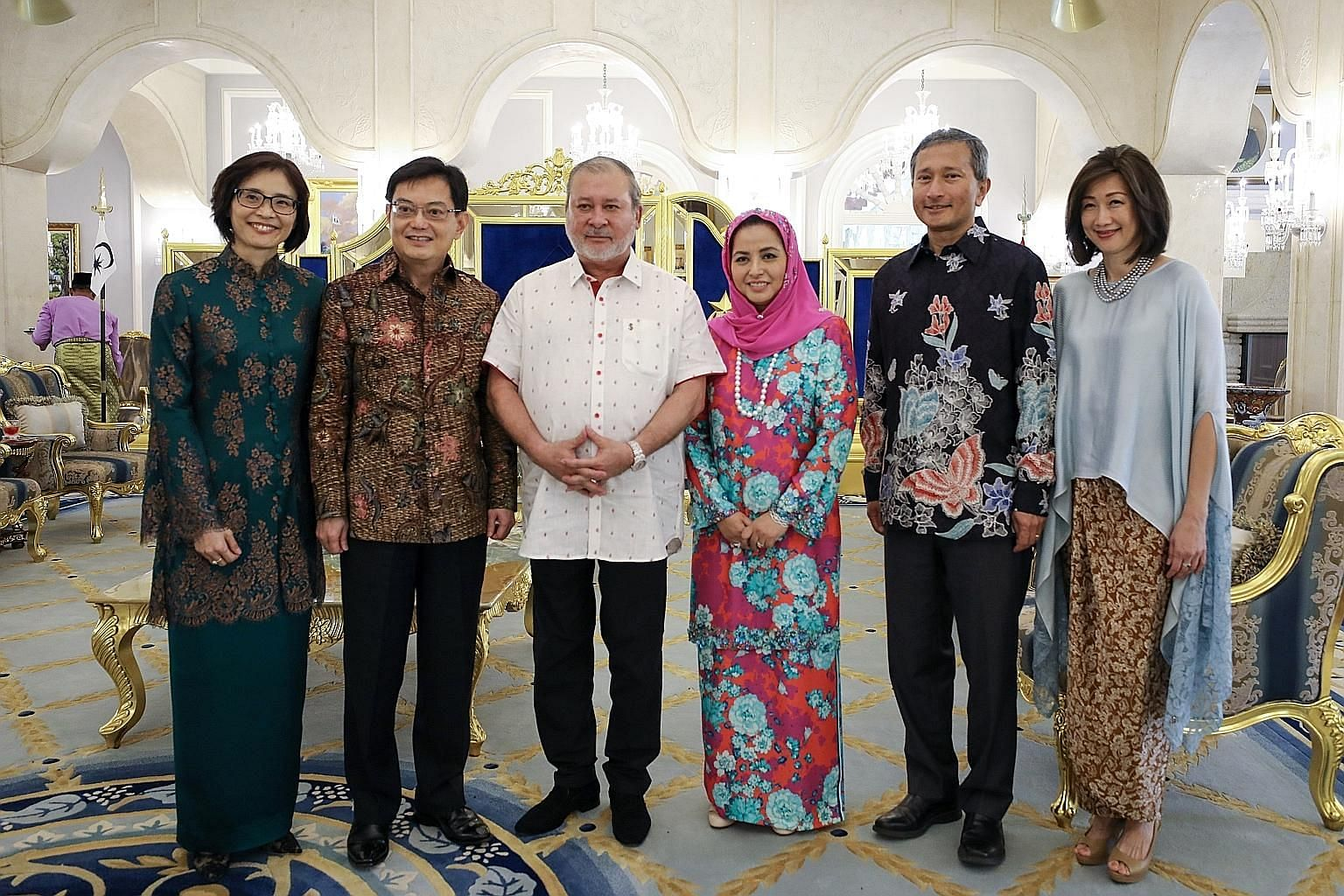 Johor's Sultan Ibrahim Sultan Iskandar and his wife Raja Zarith Sofiah with Deputy Prime Minister Heng Swee Keat and his wife Chang Hwee Nee, and Foreign Minister Vivian Balakrishnan and his wife Joy at the Istana Bukit Serene in Johor Baru yesterday