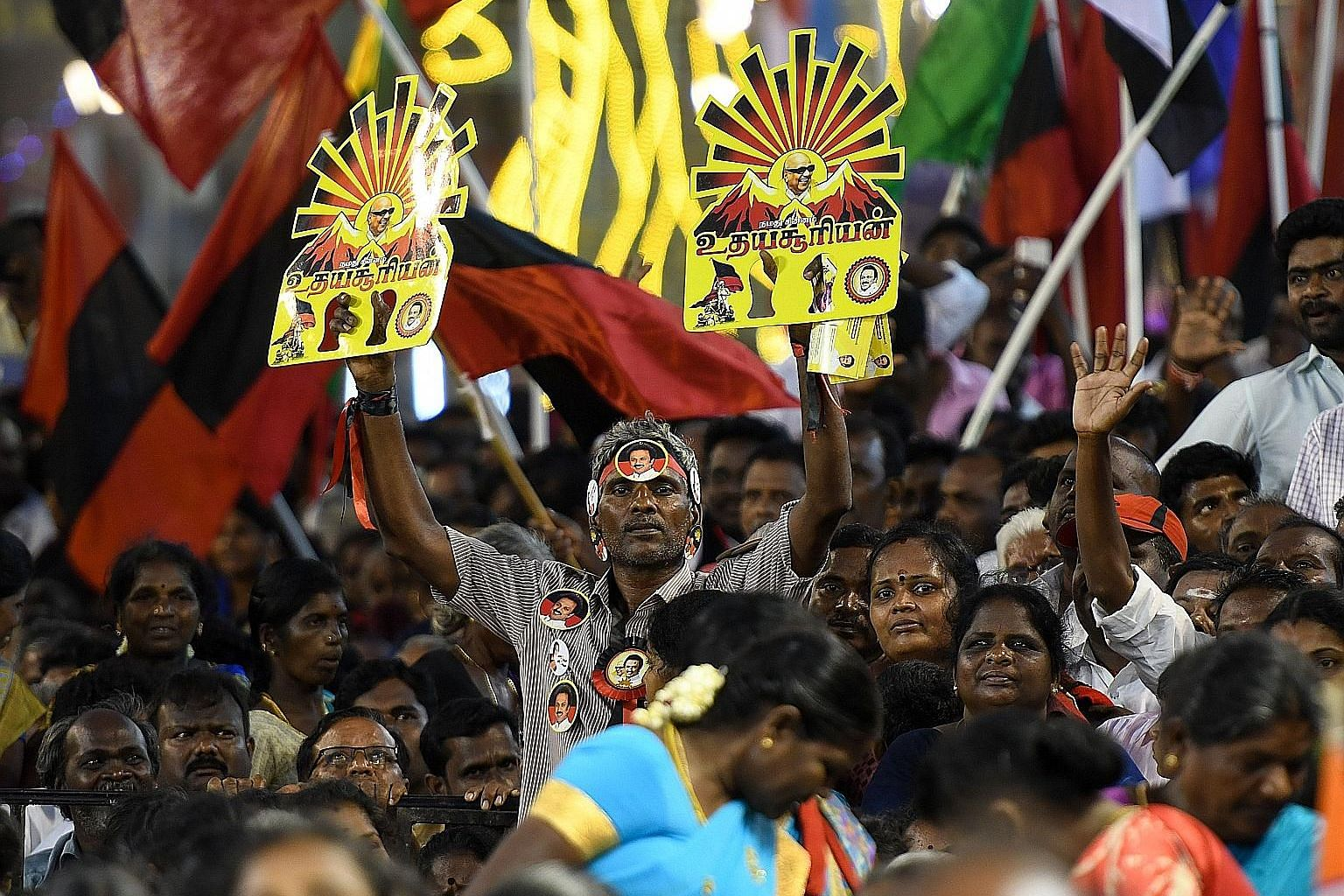 A member of the Dravida Munnetra Kazhagam showing support for the party with placards during an election rally in India's Tamil Nadu state in April. The party is opposed to the introduction of a third compulsory language.
