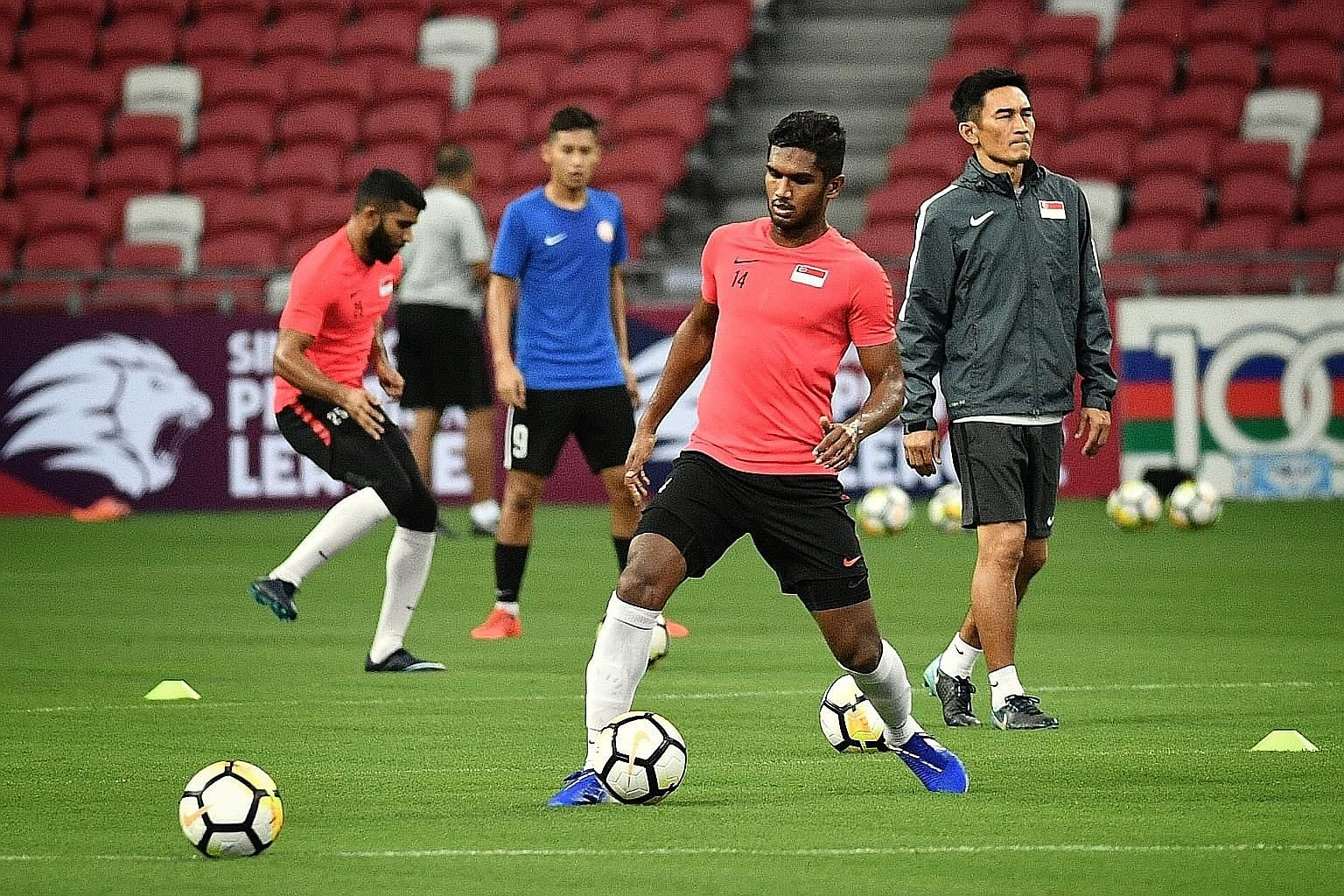 The Lions training at the National Stadium before their friendly against the Solomon Islands tonight. ST PHOTO: CHONG JUN LIANG