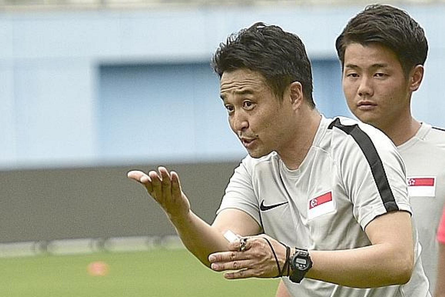 New Singapore football coach Tatsuma Yoshida, with translator Ryo Ishibashi, during his first training session with the players.
