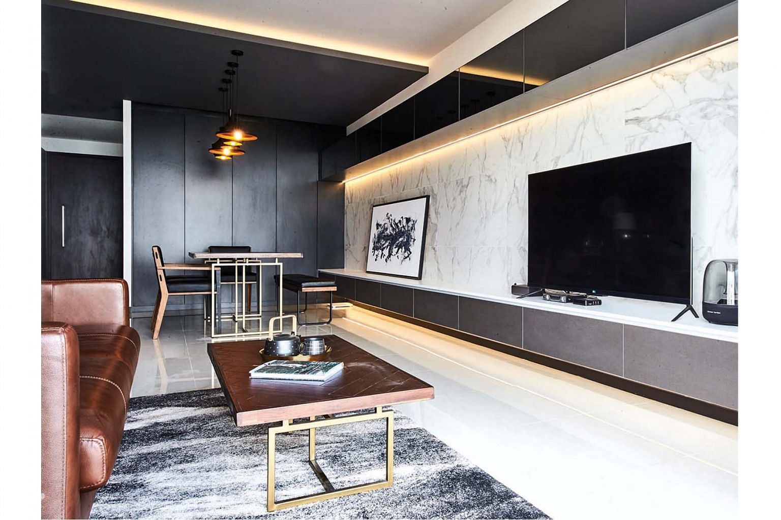 One of the home owners always dreamt of a marble feature wall, but large slabs of marble were not readily available and difficult to transport into smaller apartments, so she opted for tiles.