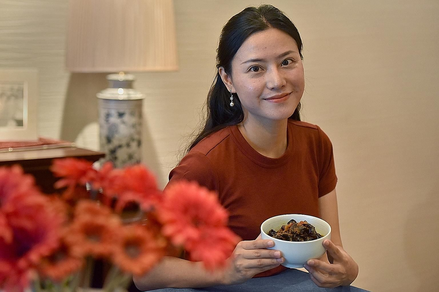 Housewife Liu Yaling with her spicy and sour fungus dish.