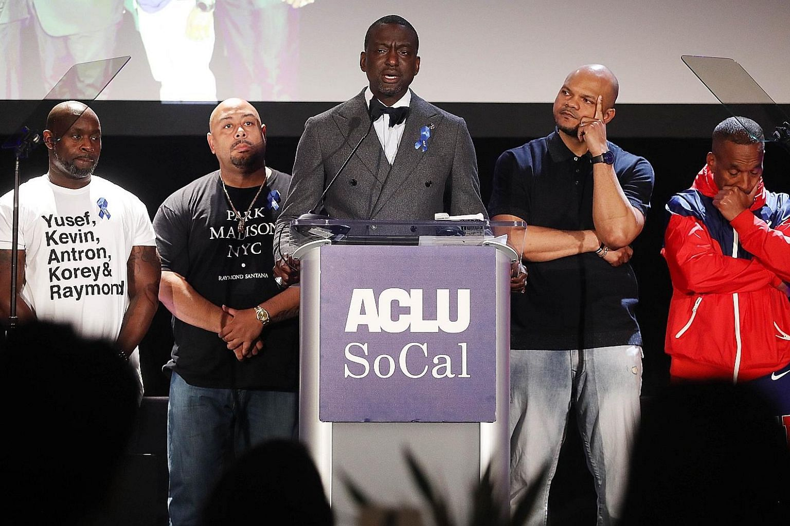 Mr Yusef Salaam speaking at the American Civil Liberties Union of Southern California's awards luncheon in Los Angeles on Friday, where he and (from left) Antron McCray, Raymond Santana, Kevin Richardson and Korey Wise were honoured. They were wrongf