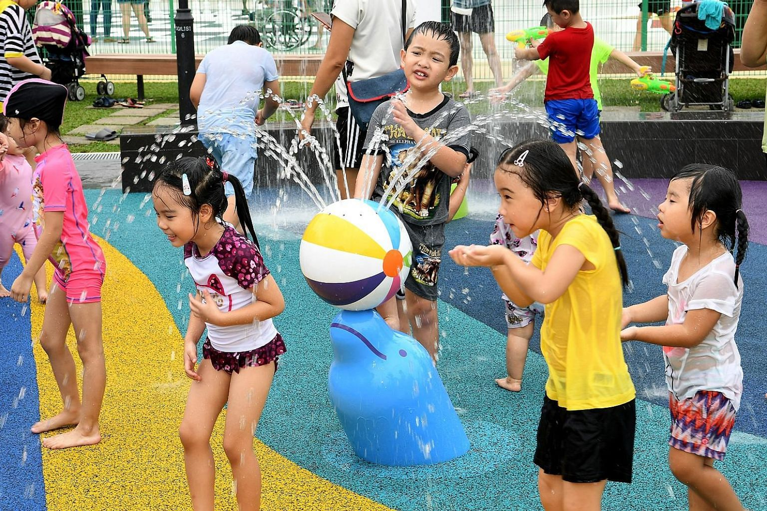Children enjoying the water play zones at Oasis Waterpark @ Nee Soon East after its launch yesterday.