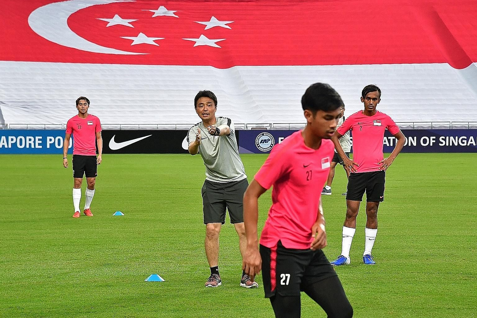 Lions coach Tatsuma Yoshida giving his players instructions during their training session at the National Stadium yesterday, ahead of the friendly against Myanmar.