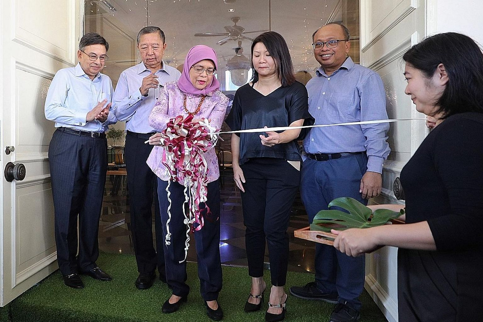 President Halimah Yacob with (from far left) Singapore Centre for Social Enterprise (raiSE) chairman Gautam Banerjee, PCSEA committee chairman Tan Soo Nan, Bliss Group founder Christine Low, and raiSE chief executive Alfie Othman at the official open