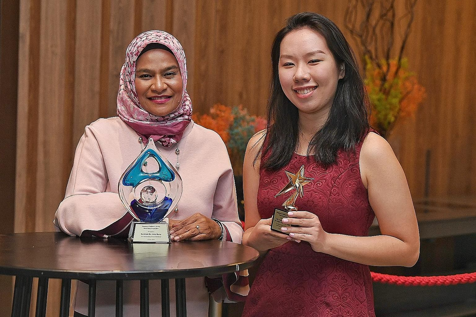 Long-time volunteer Rashidah Abdul Rasip was awarded the Singapore Children's Society's prestigious Ruth Wong Award, while Ms Go Li Jia collected the gold award on behalf of her late aunt, Ms Angela Koh Chay Yong, who died in 2017 and left $50,000 to