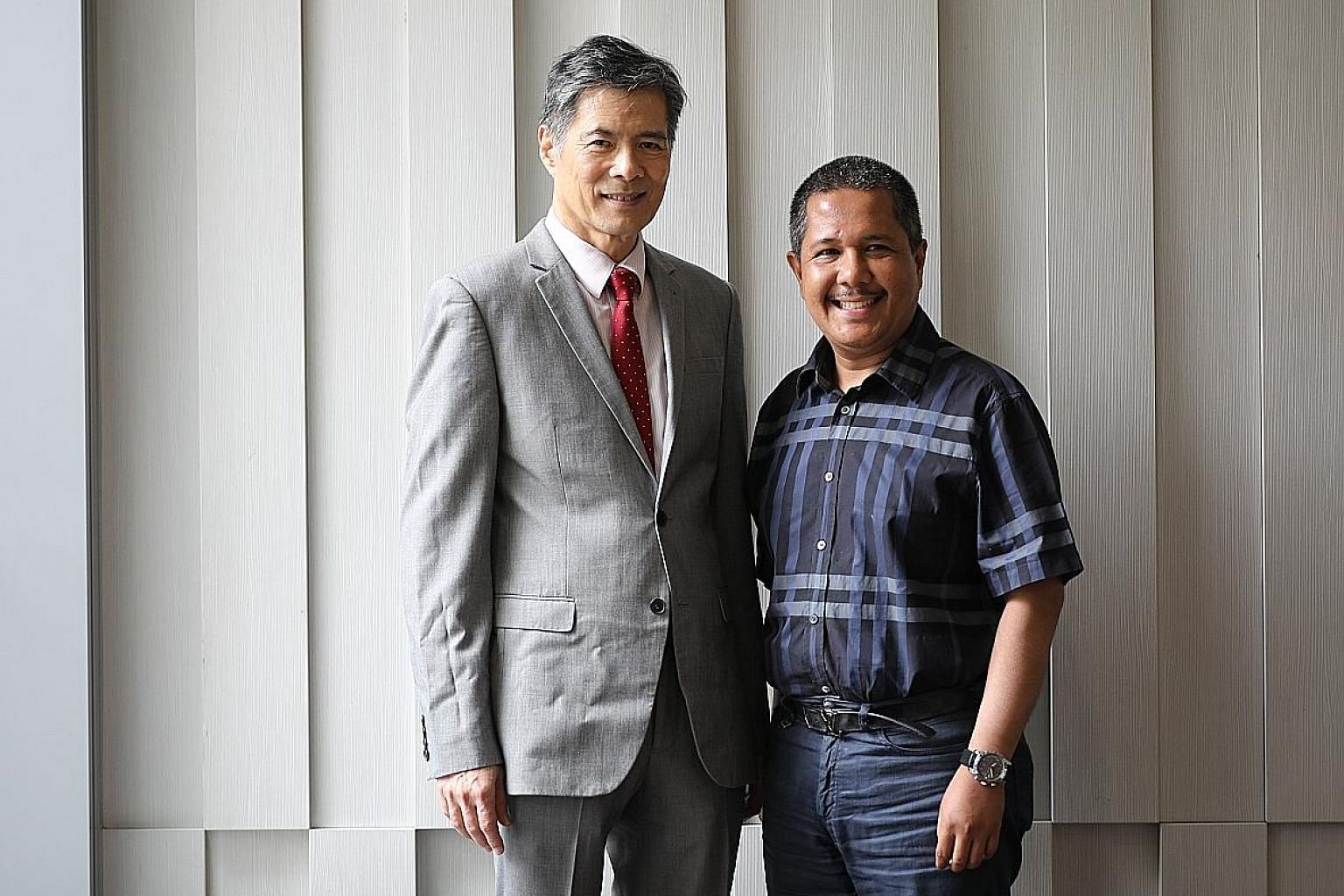 Professor Lim Seng Gee with Mr Arfan Awaloeddin, who has been functionally cured of hepatitis B under a new study led by Prof Lim. ST PHOTO: ONG WEE JIN