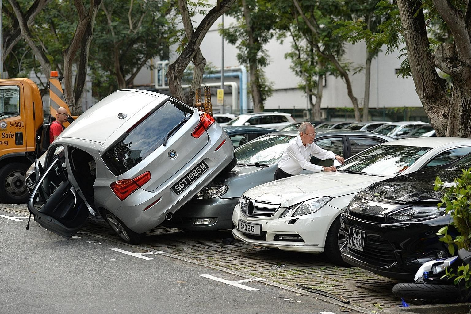 A BMW driven by an elderly woman ended up on two other cars in a carpark next to Wheelock Place at about 4pm yesterday. No injury was reported. The Straits Times understands that the Singapore Civil Defence Force deployed two fire bikes, one red rhin