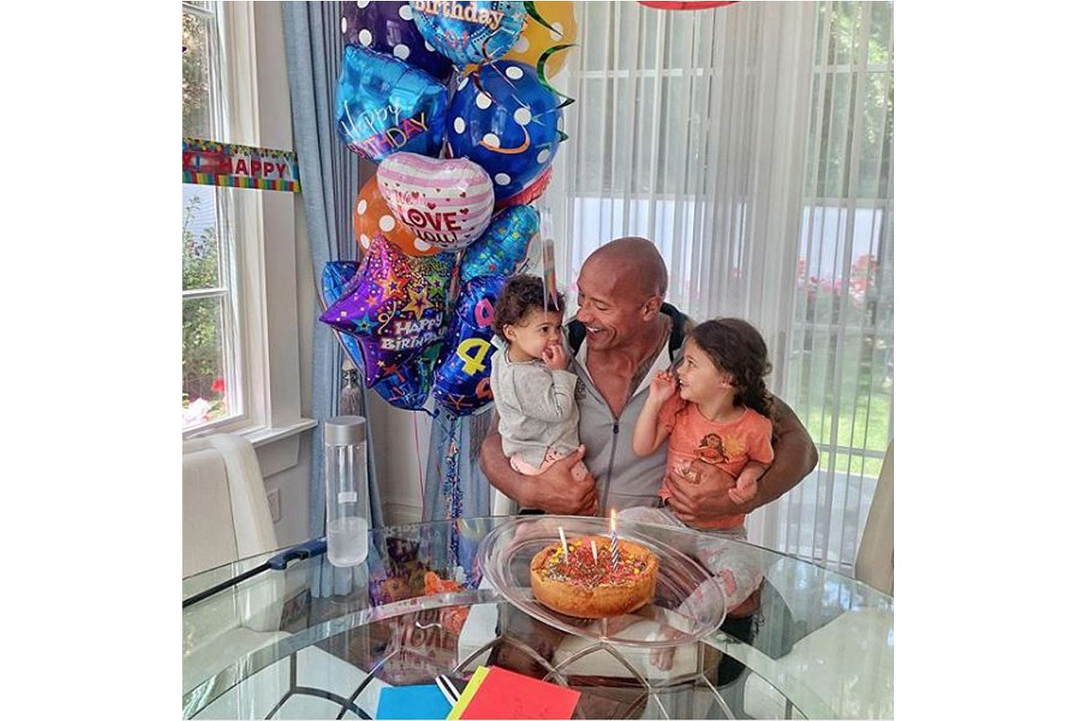 """THE ROCK BLASTED OVER DAUGHTER'S PHOTO: Netizens are throwing """"rocks"""" at Dwayne Johnson after he recently posted a photo of himself and his daughter at a swimming pool. Three-year-old Jasmine was not in a swimsuit, prompting some to question the act"""