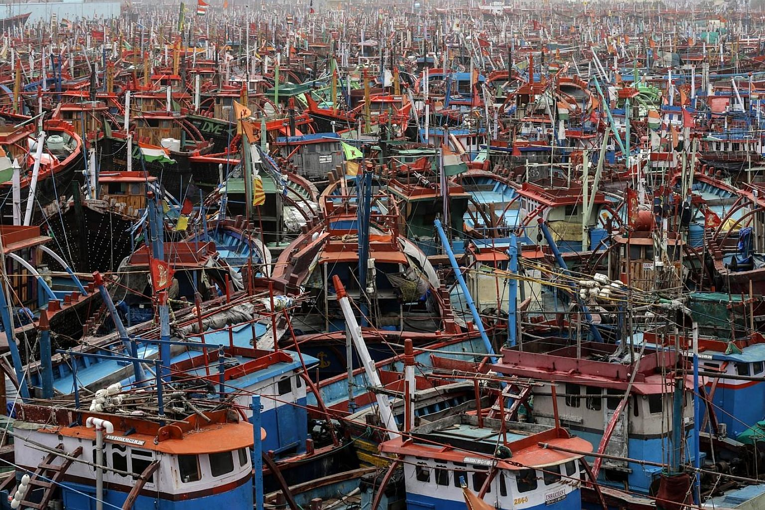 Fishing boats anchored near the Arabian Sea coast as Cyclone Vayu was about to land in India on Thursday. Although Western India was hit by high winds and heavy rains, the cyclone veered away instead into the Arabian Sea late on Thursday. Cyclone Vay