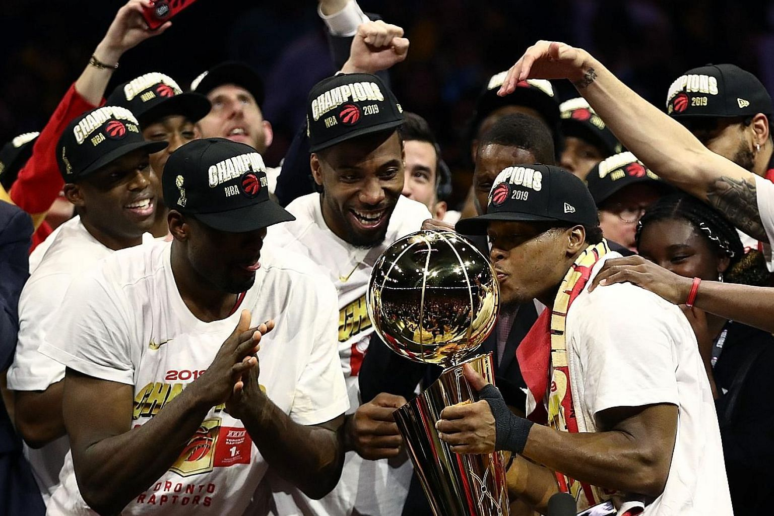 The Toronto Raptors celebrate with the Larry O'Brien Championship Trophy after defeating two-time defending champions Golden State Warriors 114-110 in Game Six for a 4-2 victory in the NBA Finals.