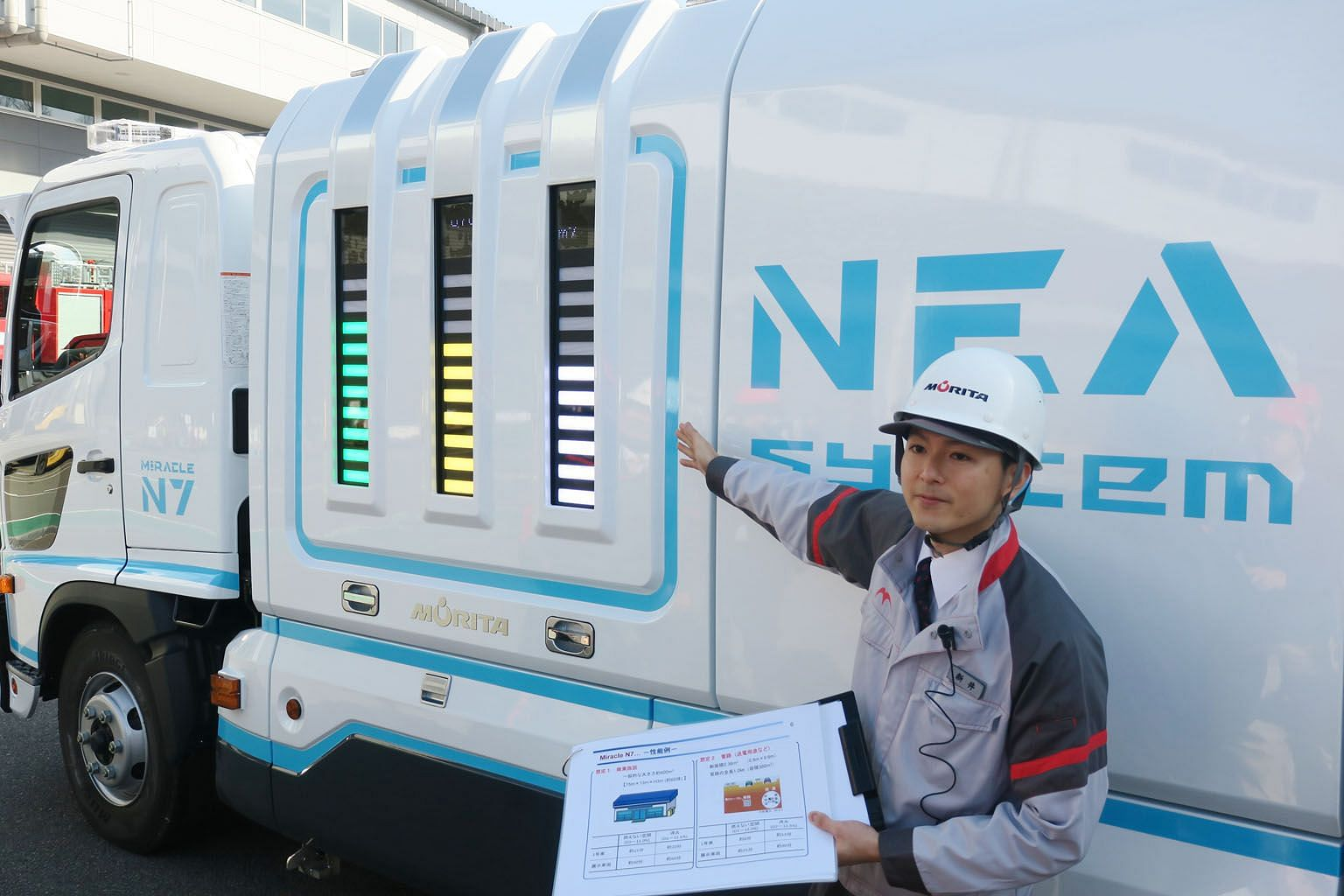 Morita engineer Toshimitsu Arai points to the company's new fire truck that uses a new Nitrogen Enriched Air system to fight fires.