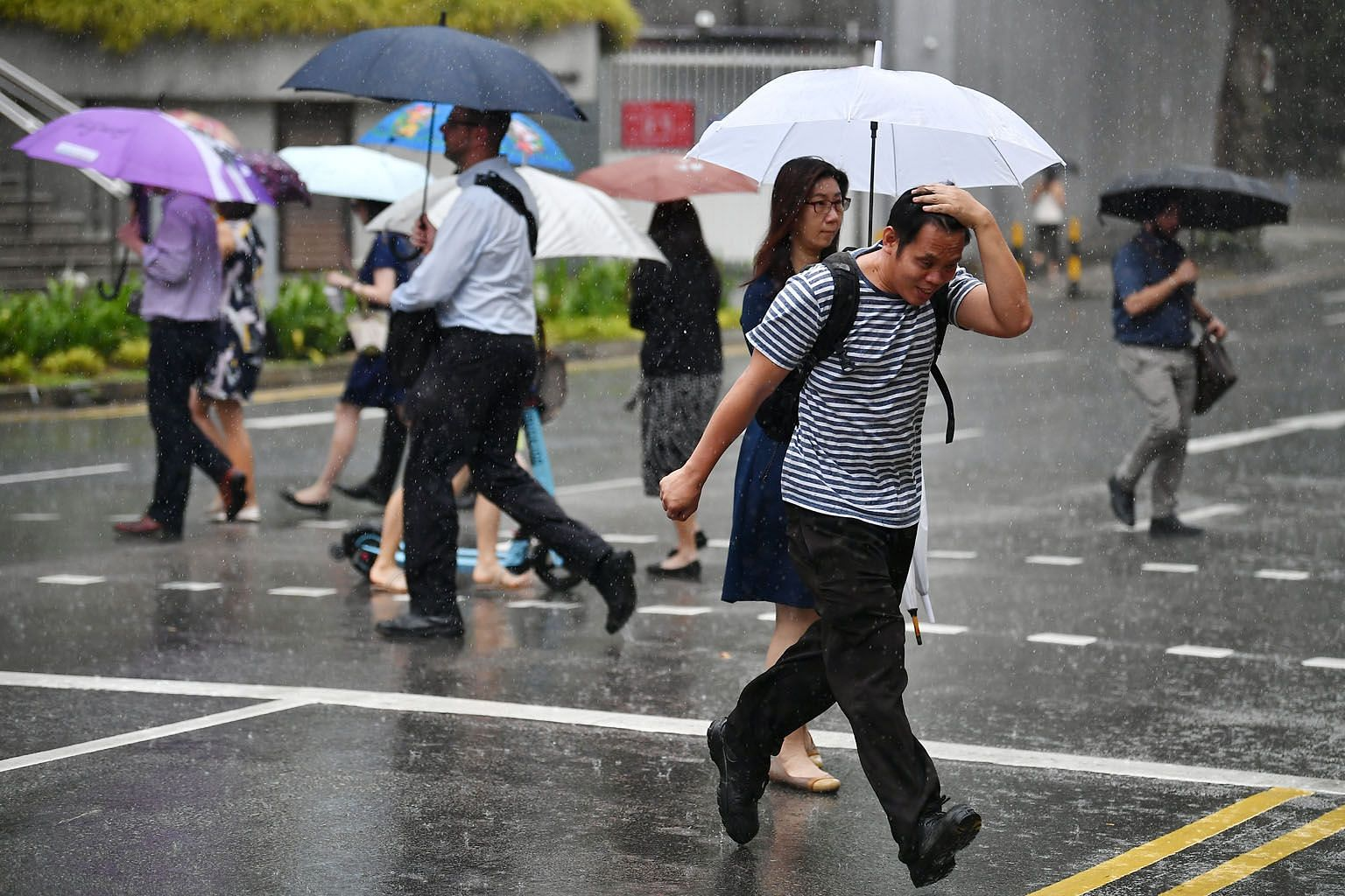 In the second half of this month, showers are forecast to take place mostly in the late morning and in the early afternoon. On some days, the showers are expected to extend into the late afternoon and evening. ST PHOTO: LIM YAOHUI