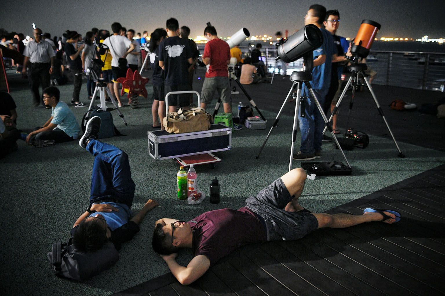 People on the roof of the Singapore Maritime Gallery on July 27 last year waiting to witness a total lunar eclipse. For the annular solar eclipse on Dec 26, the best view of the phenomenon is from the southern part of Singapore.