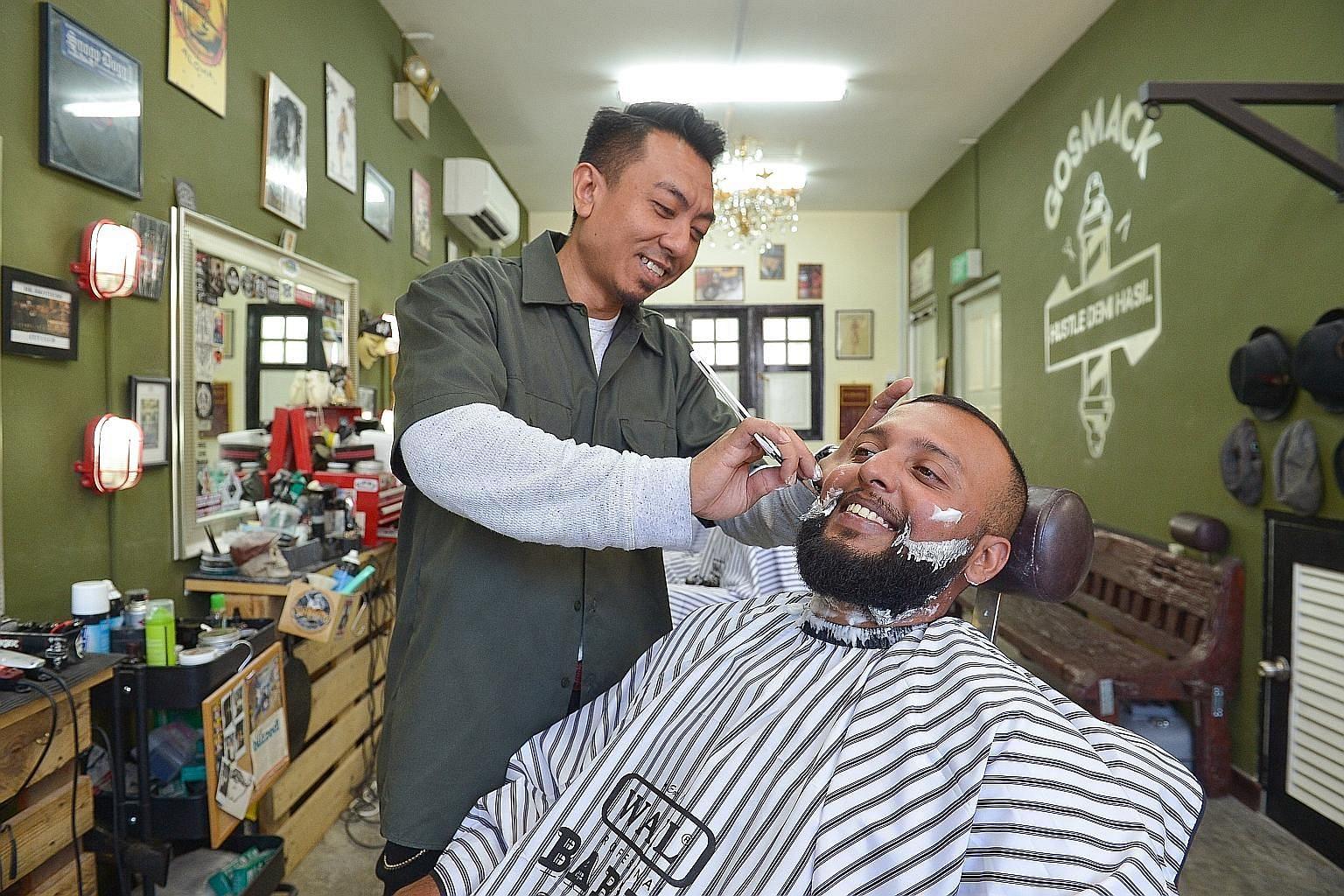Co-owner of Gosmack Barbershop Art Mirzi giving events coordinator Gopi Kalipermal a shave.
