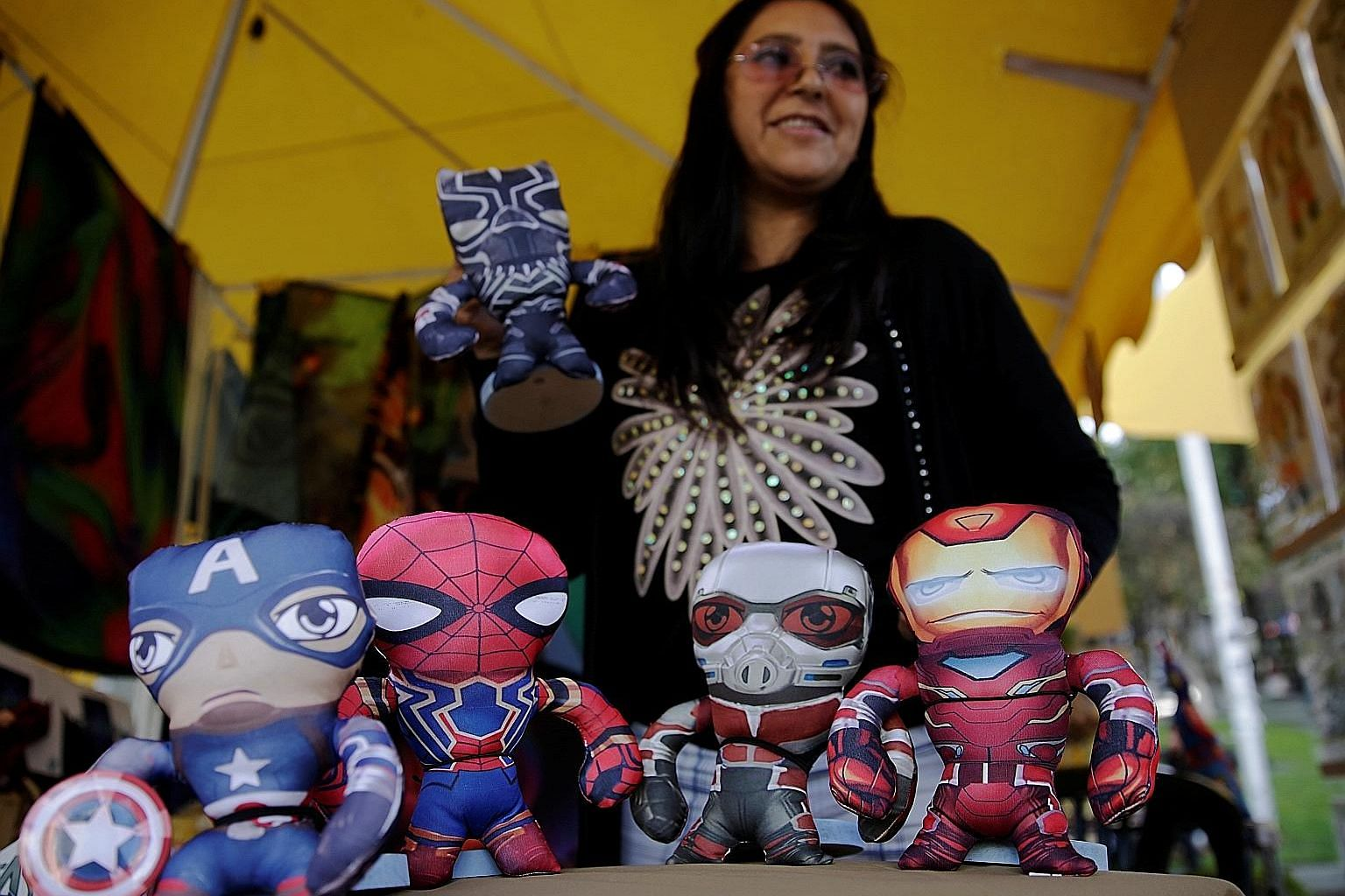 A vendor selling Avengers toys at a fair in Bolivia. Last month, Avengers: Endgame booked $838 million in China, becoming the highest-grossing American film in the country's history. If the China market is cut off, it could result in a reduction of t