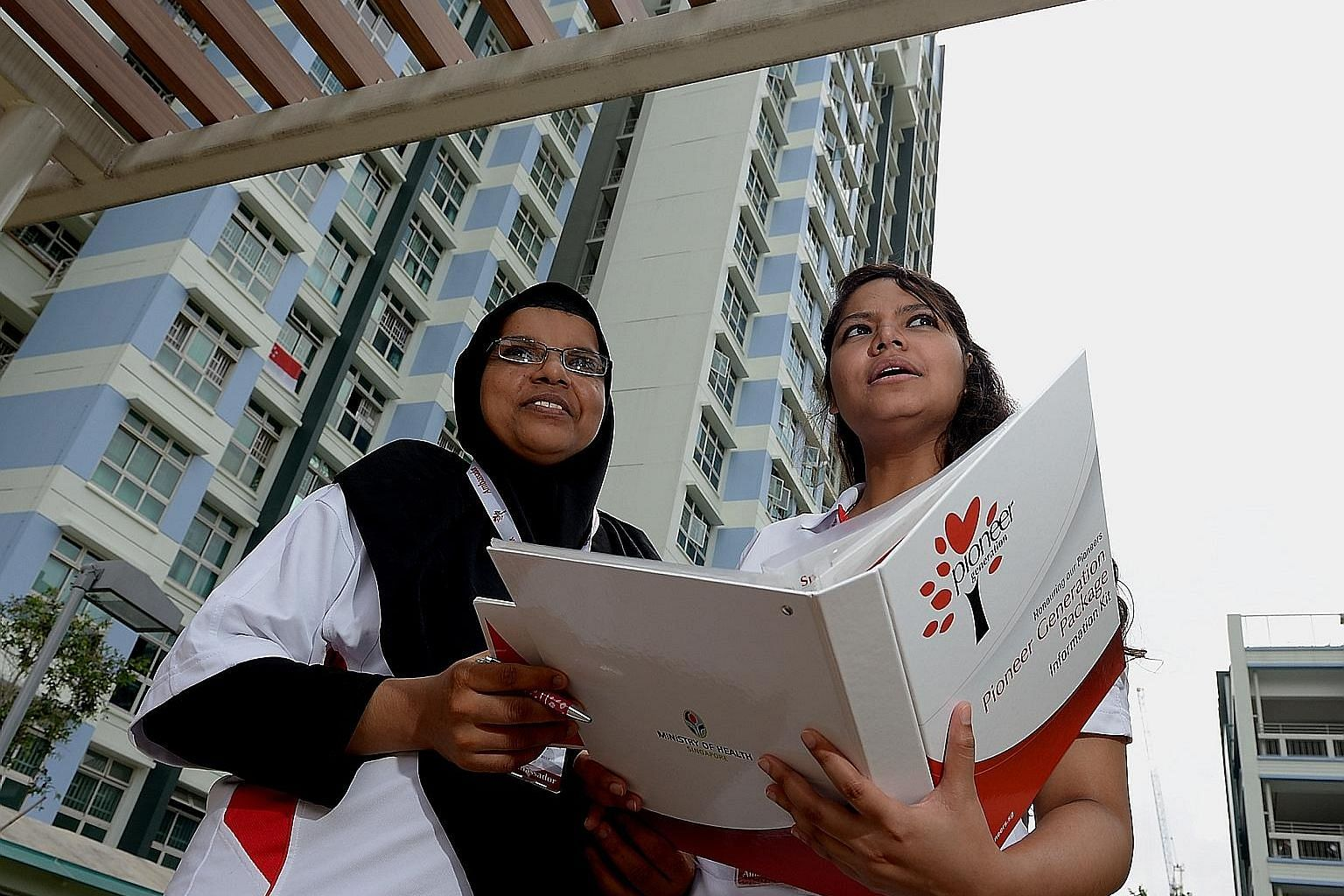 Volunteers Badrun Muneera Mohamed Ali (left) and Nuraeen Basir out to explain the Pioneer Generation Package to beneficiaries in 2015. The package was the result of many Singaporeans' wish for more inclusive healthcare coverage, says Deputy Prime Min