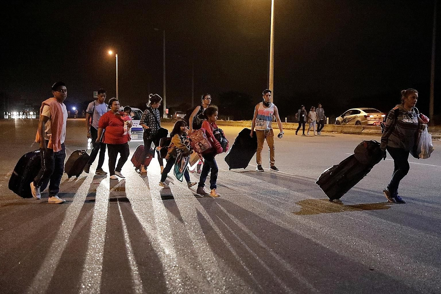 Venezuelan migrants arriving at the Peruvian border town of Tumbes on Friday, ahead of a new law that requires all Venezuelan migrants to have valid visas and passports.