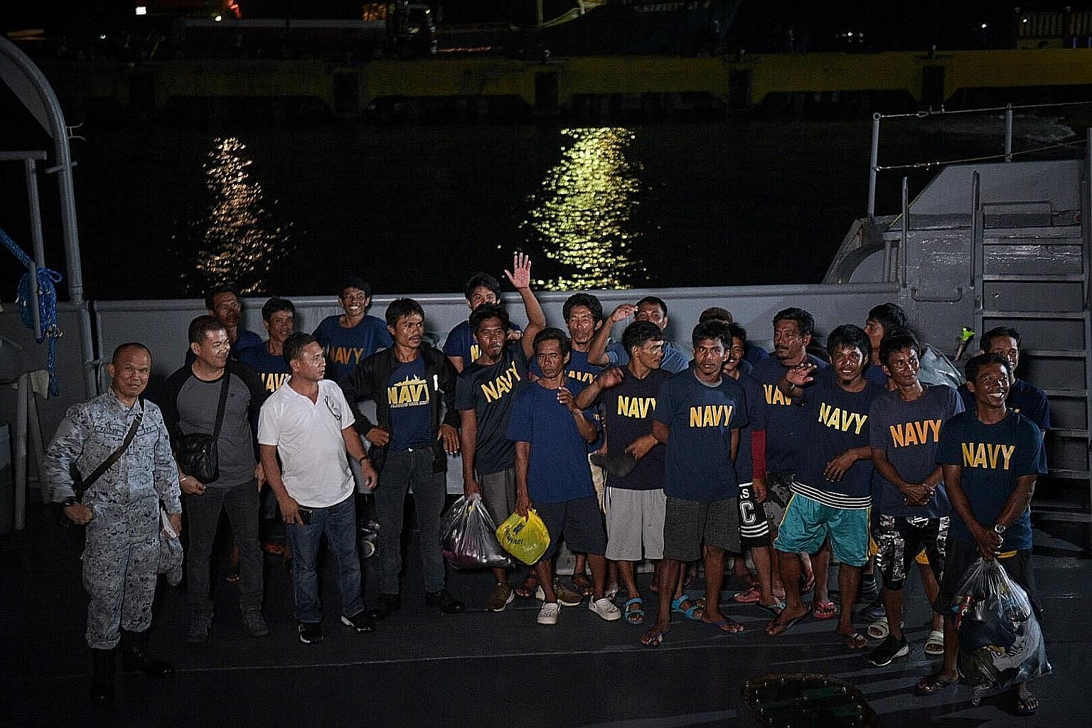 Filipino fishermen returning home on board a Philippine Navy vessel after their outrigger, the Gem-Vir, was allegedly hit by a Chinese vessel in the South China Sea. The 22 fishermen were later rescued by a Vietnamese boat. The Philippines has lodged