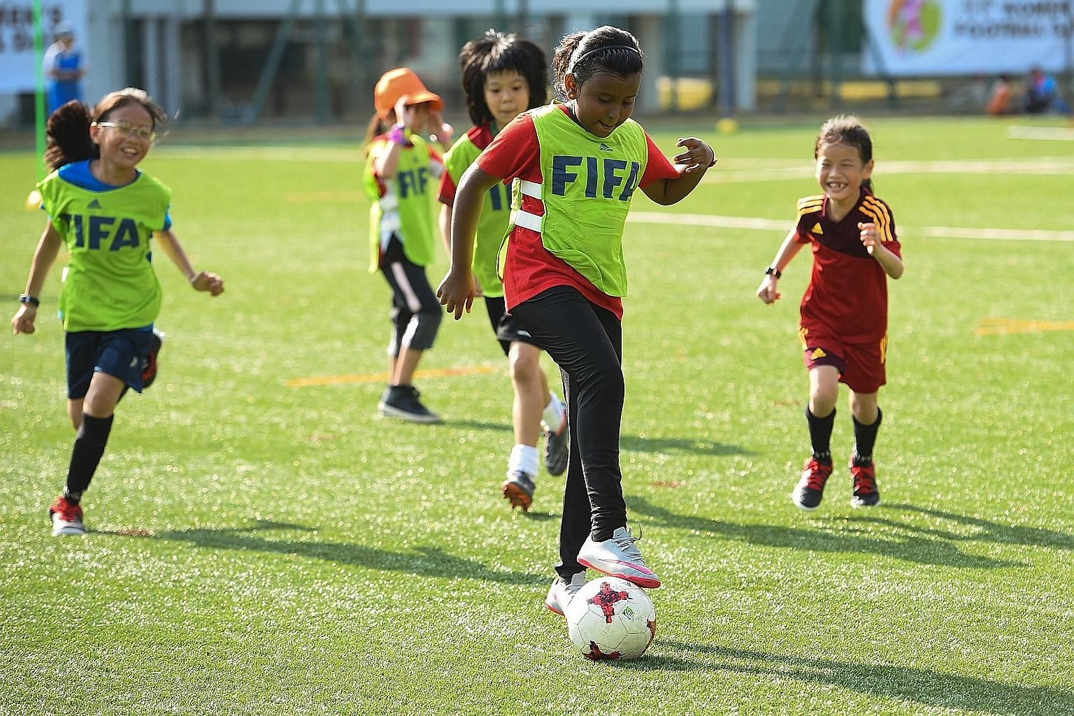 Young girls enjoying a game during the Football Association of Singapore Women's Football Day at Bowen Secondary School in March. More girls are taking up the sport but more support, in terms of training, finances and publicity, is needed.