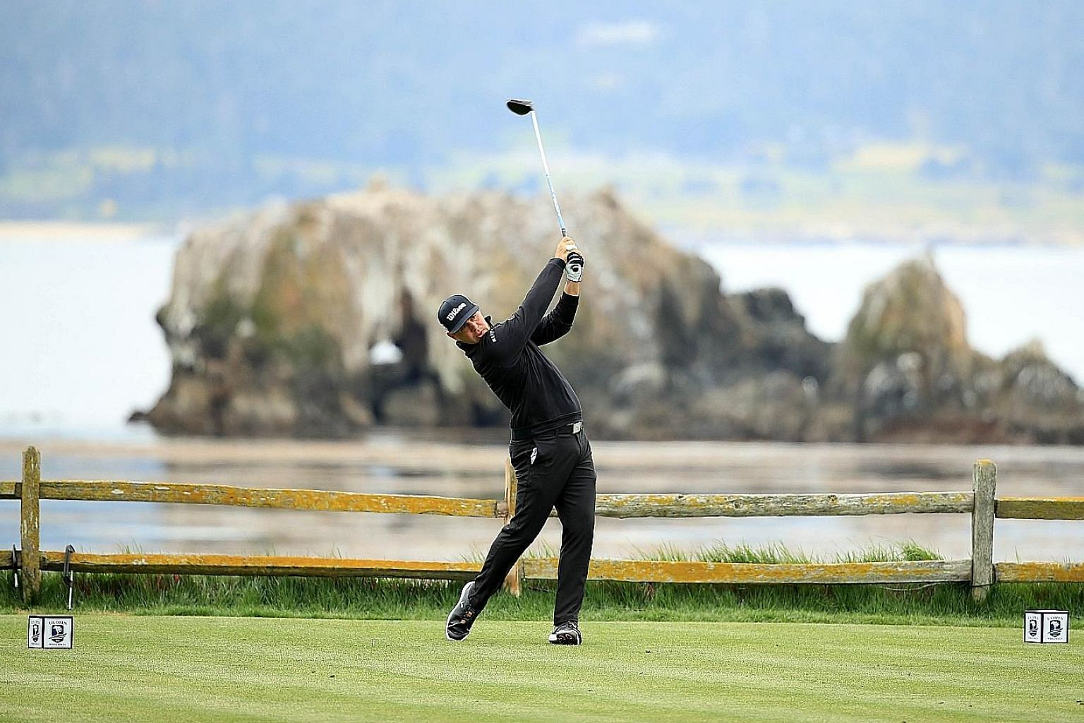 American Gary Woodland teeing off at the 18th hole during the second round of the US Open at Pebble Beach on Friday. He shot a record-equalling six-under 65 for a nine-under 133 total to take a two-shot lead into the third round.