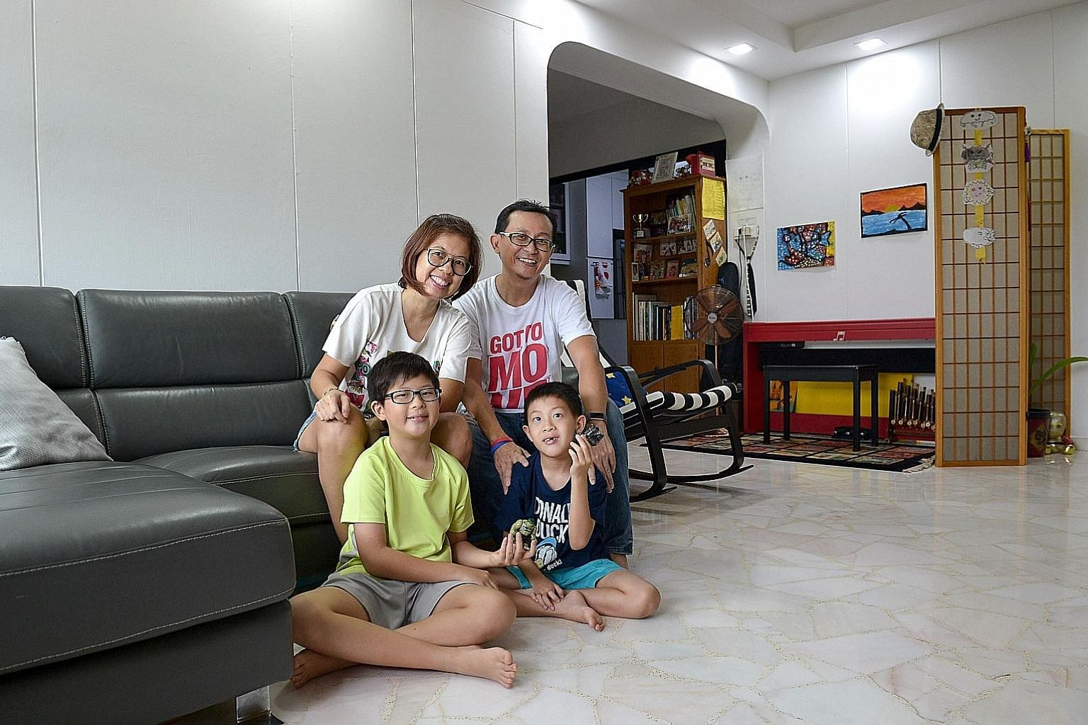 Former poly lecturer Kelvin Seah, 49, gave up his job last year to care for his sons Jaedon, 10, and Caleb, eight. His wife, Ms Lim Shaw Hui, 47, is a social worker.