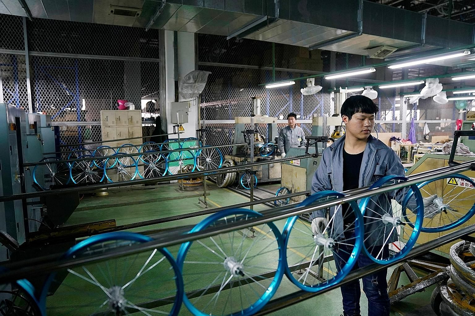 The Kent bicycle production lines at Shanghai General Sports in Kunshan in China's Jiangsu province. If its factory in Cambodia is built at full speed, the Chinese manufacturer could be producing 50,000 bicycles a month by the middle of next year.