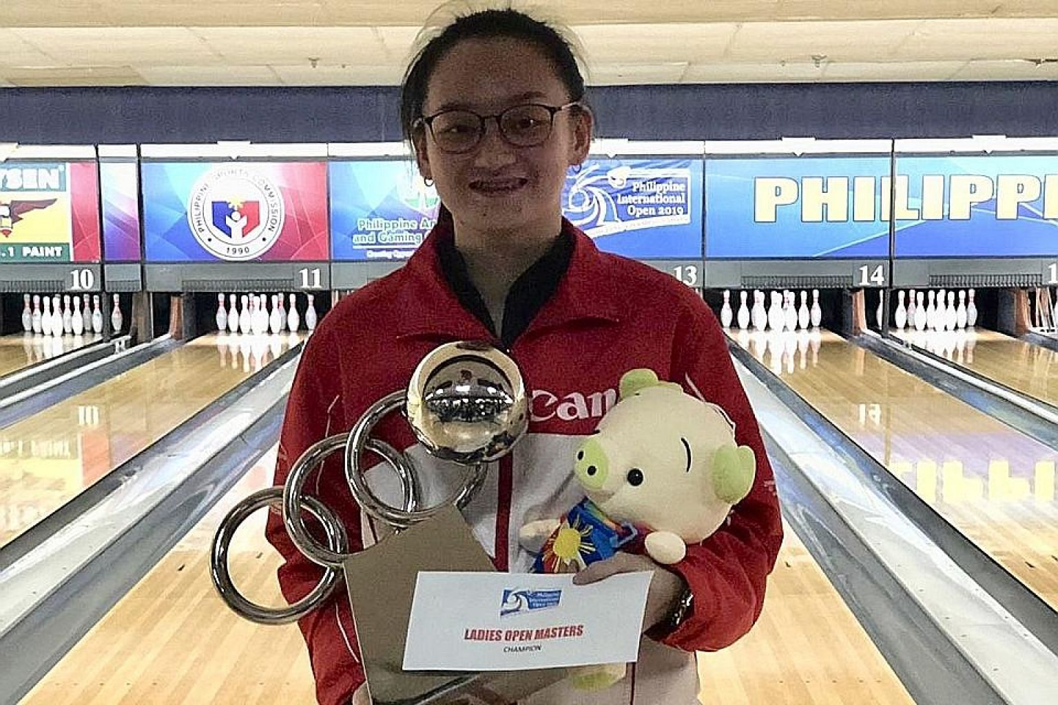 National training squad bowler Amabel Chua is all smiles after winning her first international title in Manila on Saturday. PHOTO: SINGAPORE BOWLING FEDERATION