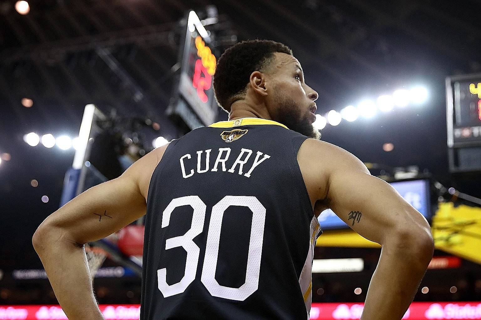 Stephen Curry and his Warriors have lost touch with their working-class fan base in their rush to become a big-money side. PHOTO: AGENCE FRANCE-PRESSE