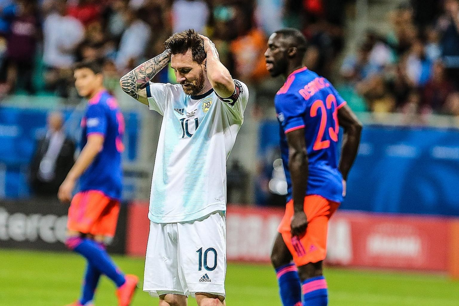 Argentina forward Lionel Messi shows his frustration during the 2-0 Copa America Group B defeat by Colombia on Saturday - the first competitive loss to their neighbours in 12 years. PHOTO: DPA