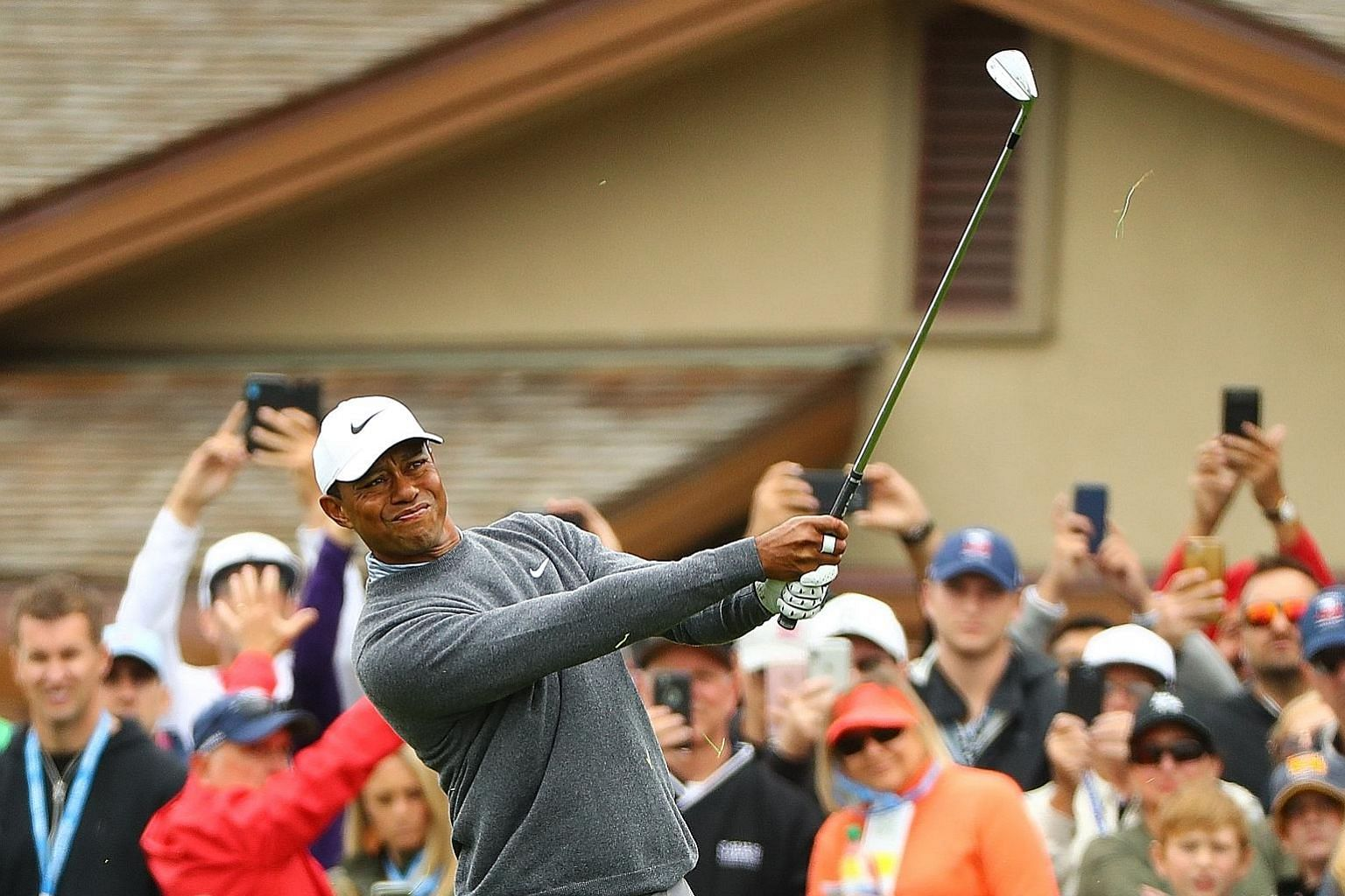 Tiger Woods playing a shot on the first hole in the third round of the US Open on Saturday at Pebble Beach Golf Links. He made bogey - one of five that day. But he mixed it up with five birdies to stand at even-par 213. PHOTO: REUTERS