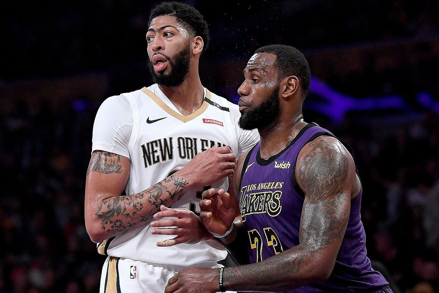 Los Angeles Lakers star LeBron James guarding Anthony Davis during their 112-104 win over the New Orleans Pelicans at the Staples Centre last December. They will play together next season as the Lakers aim to make the play-offs for the first time sin