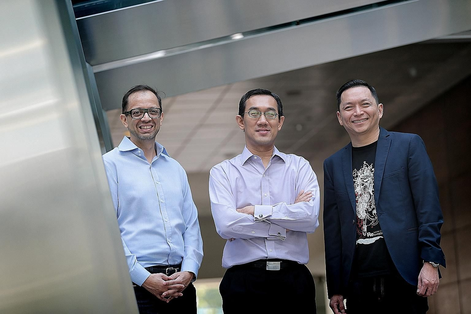 From left: MetLife Asia chief innovation officer and LumenLab chief executive Zia Zaman, SPH chief of digital business Julian Tan and NTUC Income chief operating officer Peter Tay.