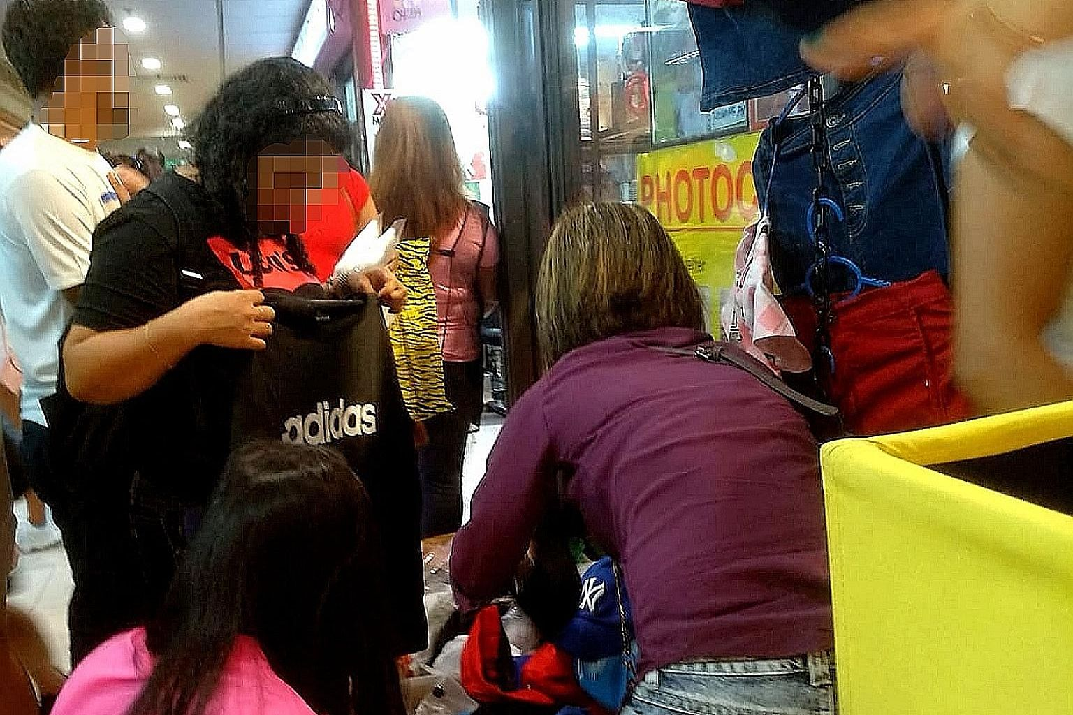 Counterfeit apparel of famous brands such as Adidas, Under Armour and Levi's being sold outside a fourth-storey shop at Lucky Plaza. Those found guilty of distributing goods with falsely applied trademarks for the purpose of trade can be jailed up to