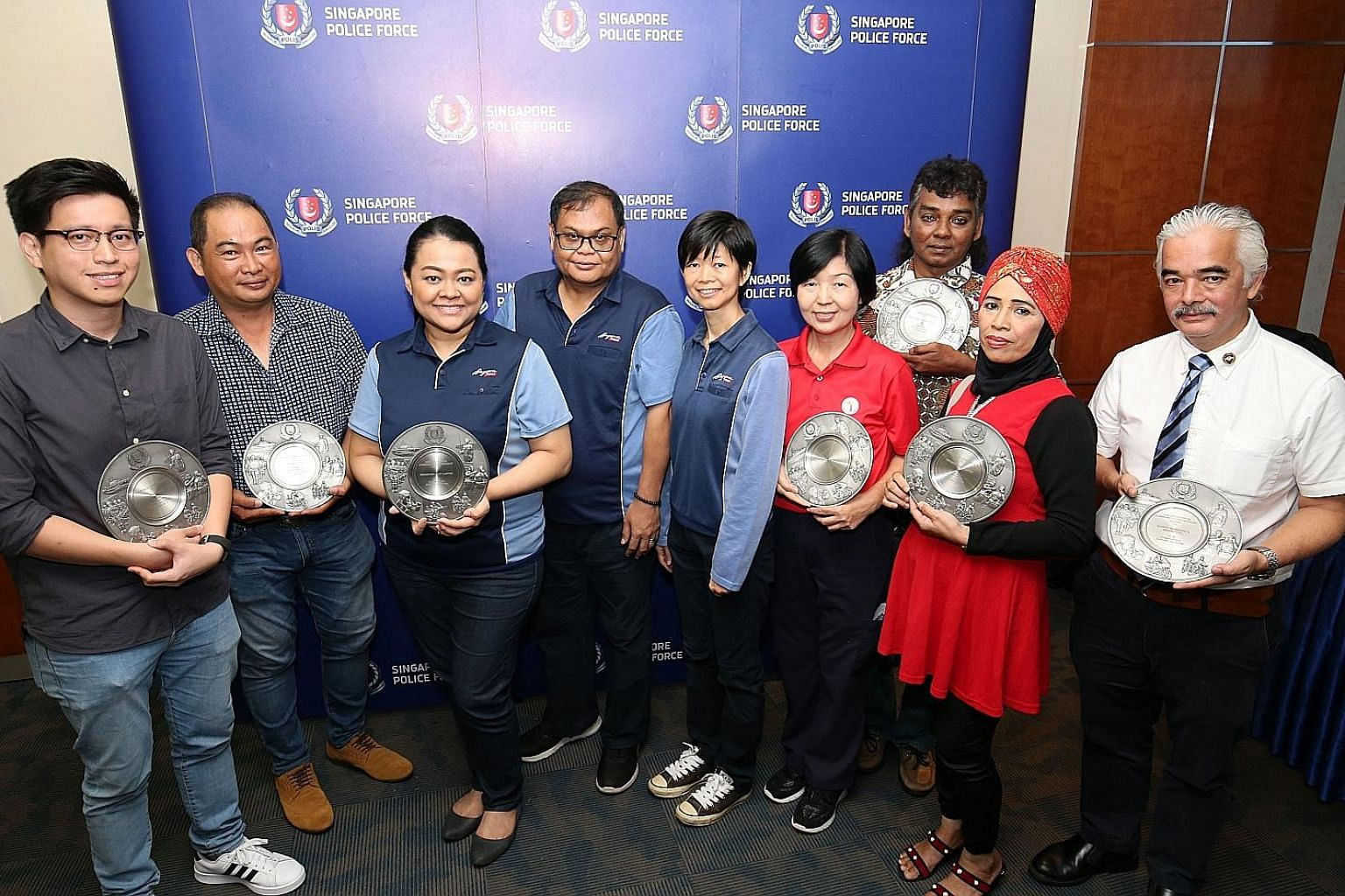 Receiving the awards yesterday were (from left): Mr Edmund Shao; Mr Tan Kay Huat, who helped to stop a man from stealing cash cards from vehicles; SingPost's Nora Yasmin Mohamed Zain, Tahir Saleh and Lee Mei Chan; Ms Winnie Tan, with Mr Abdul Hamid A