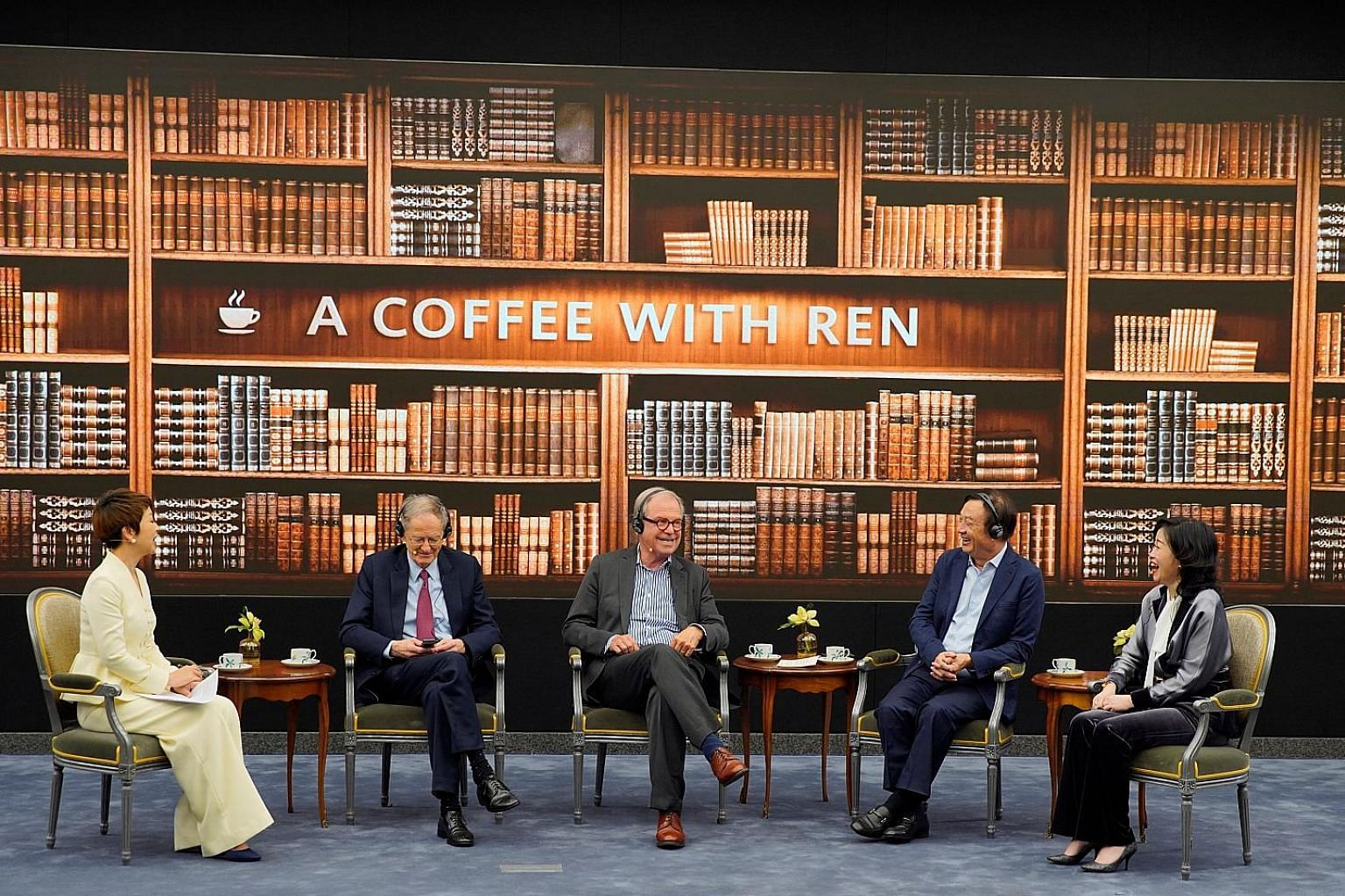 Huawei founder Ren Zhengfei (second from right) at a panel discussion with American technological expert George Gilder (second from left) and Massachusetts Institute of Technology Media Lab founder Nicholas Negroponte at the company's headquarters in