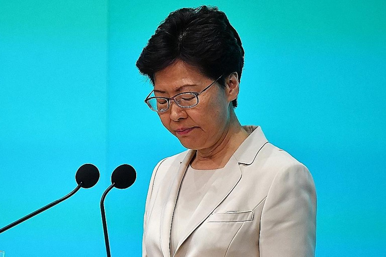 Hong Kong Chief Executive Carrie Lam at a media conference yesterday, where she apologised personally. She said she is committed to serving out her term, and appealed to the people for another chance to lead. ST PHOTO: LIM YAOHUI