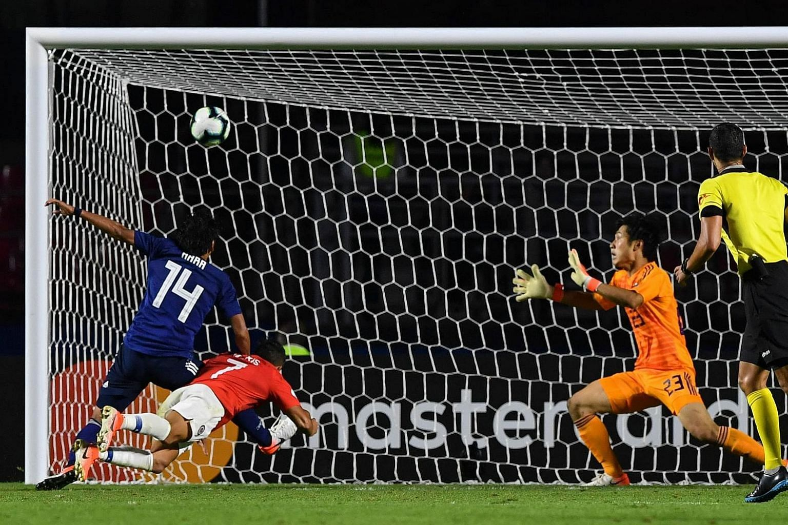 Chile's Alexis Sanchez scoring with a diving header in his side's 4-0 Copa America win over tournament guests Japan on Monday. It was the forward's first goal in five months.