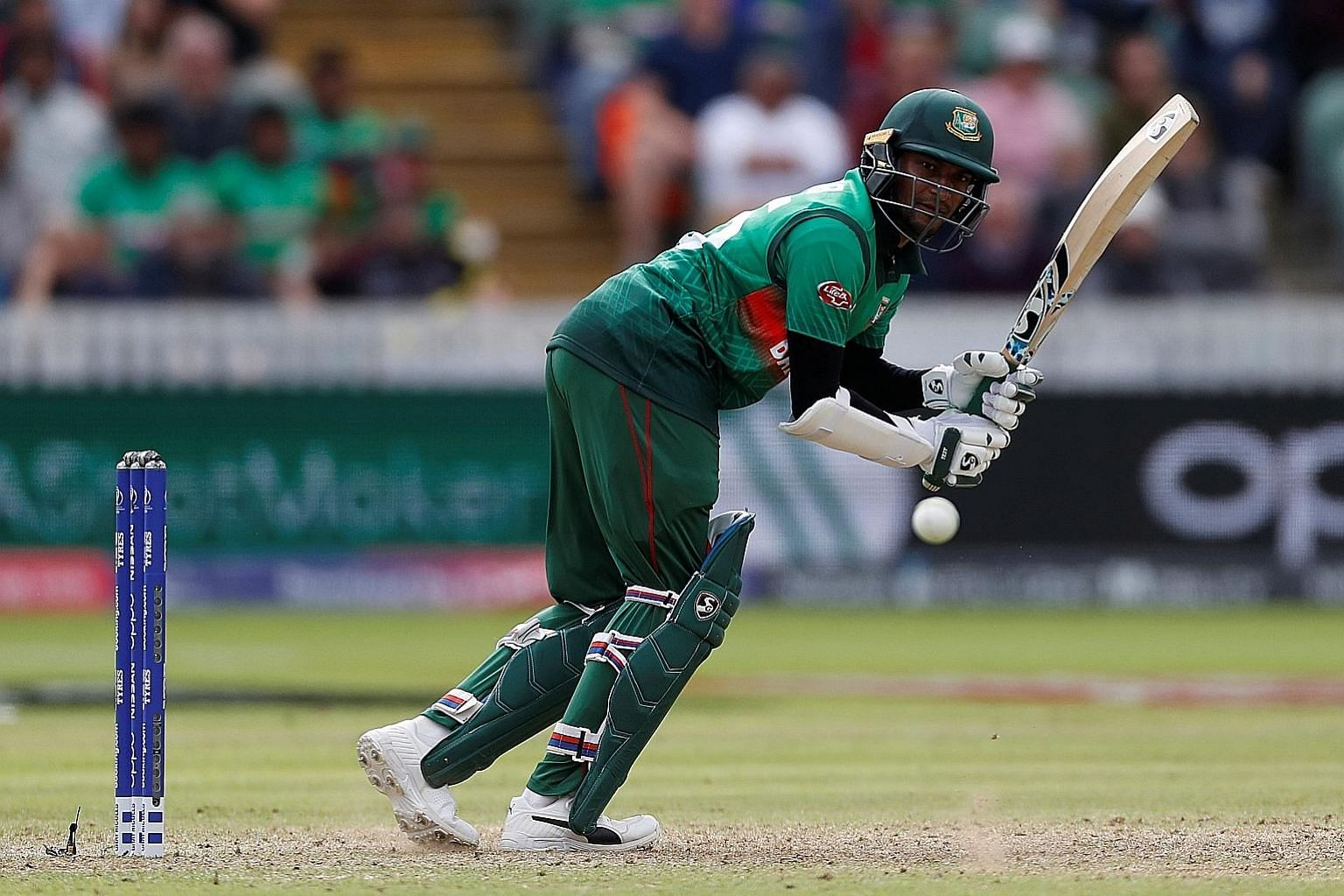 Bangladesh's Shakib Al Hasan hitting a shot against West Indies in their World Cup match in Taunton on Monday. Bangladesh won by seven wickets to keep their semi-final chances alive.