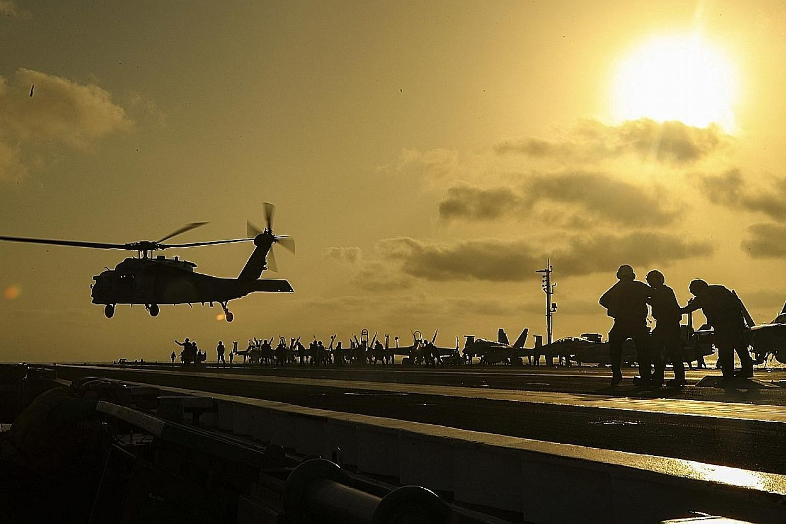 A helicopter lifting off from aircraft carrier USS Abraham Lincoln in the Arabian Sea. The US' defence chief this week announced the deployment of about 1,000 more troops to the Middle East for defensive purposes. PHOTO: EPA-EFE