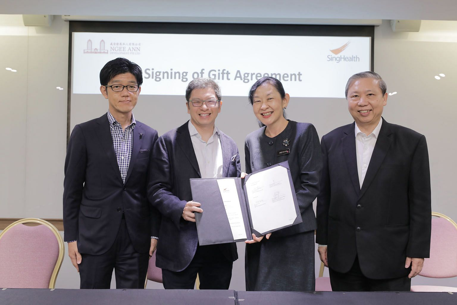 At the gift agreement signing ceremony yesterday were (from far left): Ngee Ann Development's director Tatsuo Yano and executive director Jamie Teo, and SingHealth's group CEO, Professor Ivy Ng, and deputy group CEO, Professor Fong Kok Yong.