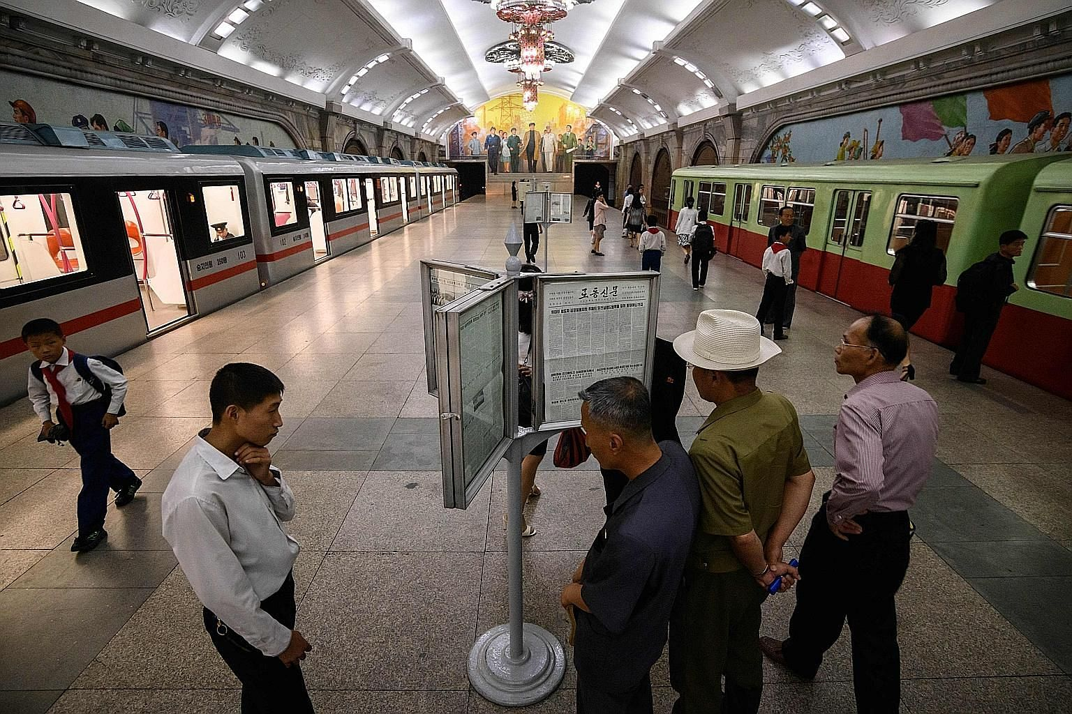 Commuters in a Pyongyang subway station, ahead of Chinese President Xi Jinping's state visit today to mark the 70th anniversary of diplomatic relations between China and North Korea. PHOTO: AGENCE FRANCE-PRESSE