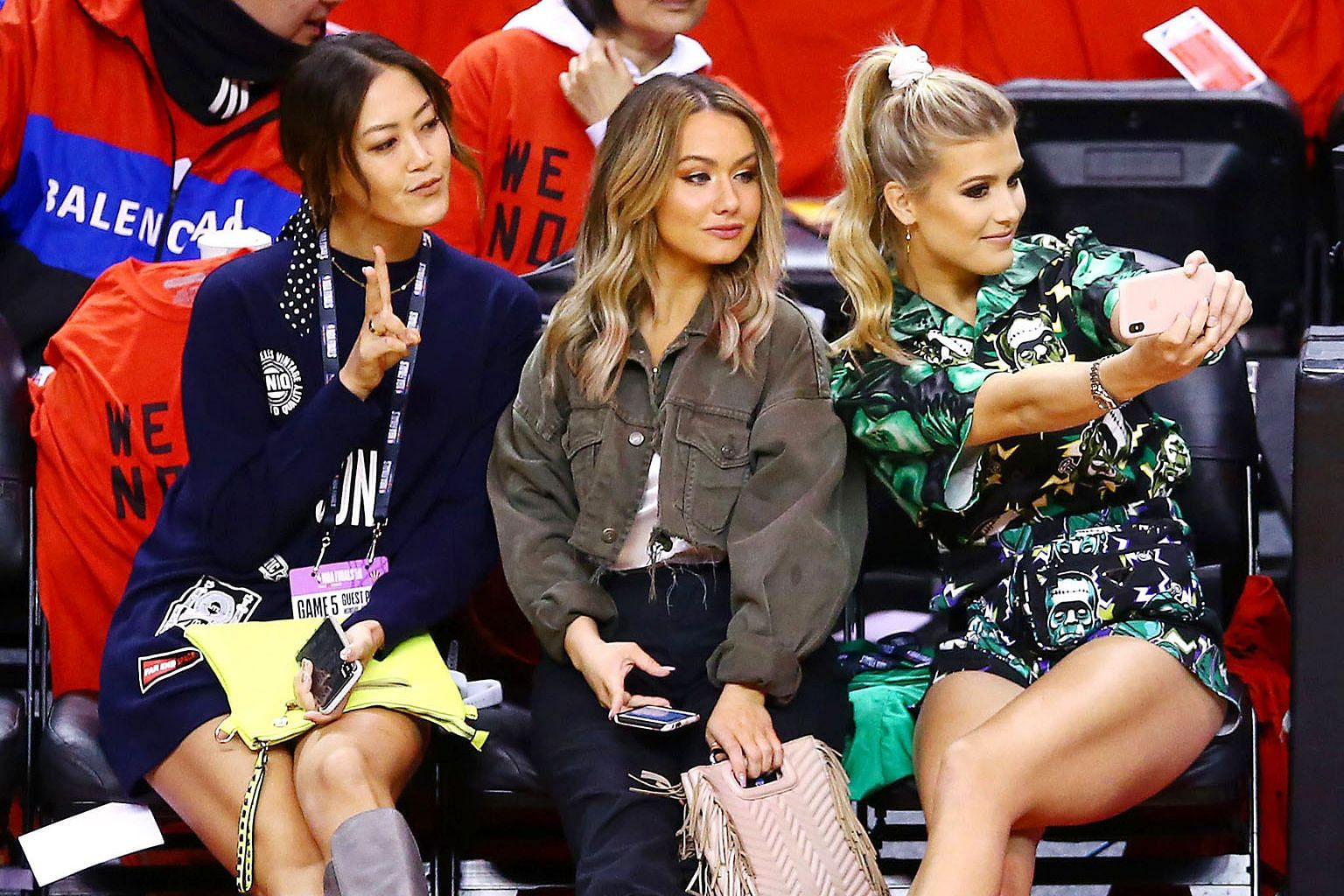 Michelle Wie, cousins Celeste and Eugenie Bouchard taking a wefie during Game 5 of the NBA Finals between the Golden State Warriors and the Toronto Raptors at the Scotiabank Arena in Toronto on June 10. PHOTO: AGENCE FRANCE-PRESSE