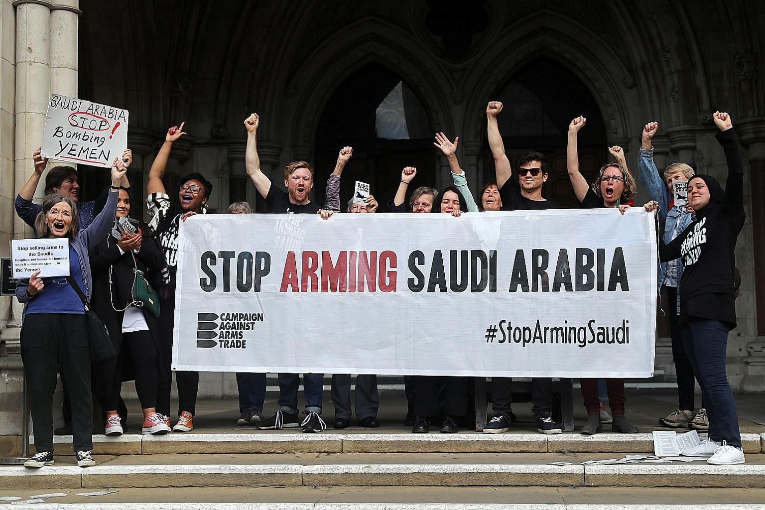 Demonstrators from the Britain-based Campaign Against Arms Trade reacting to yesterday's judgment by Britain's Court of Appeal over a legal case involving the export of arms to Saudi Arabia. The British High Court had ruled in July 2017 that the arms