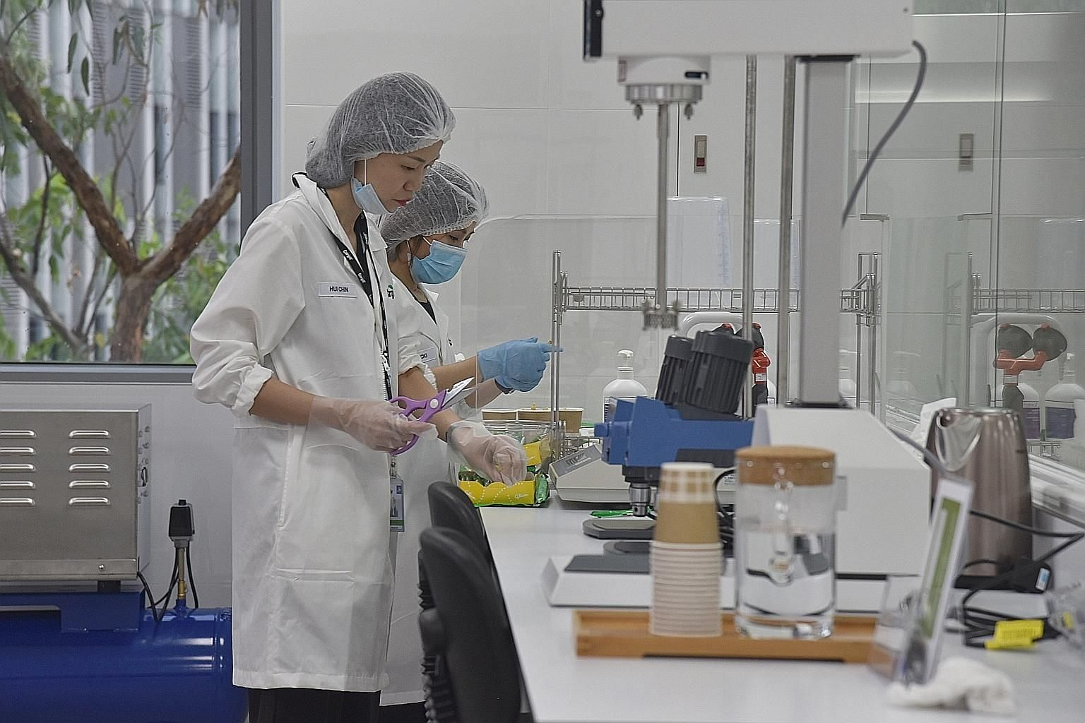Staff at the Cargill centre preparing samples of food products during a tour of the facility.