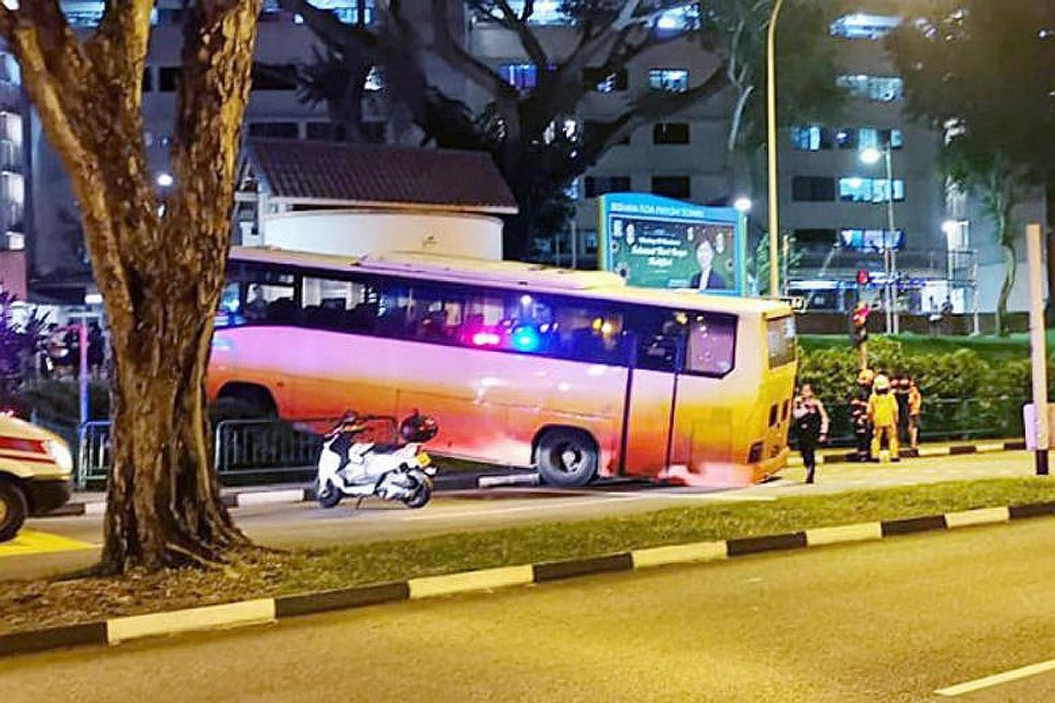 An eyewitness said the bus ran a red light before colliding with a car (left). It stopped only after it went through the barrier on the pedestrian walkway (above).