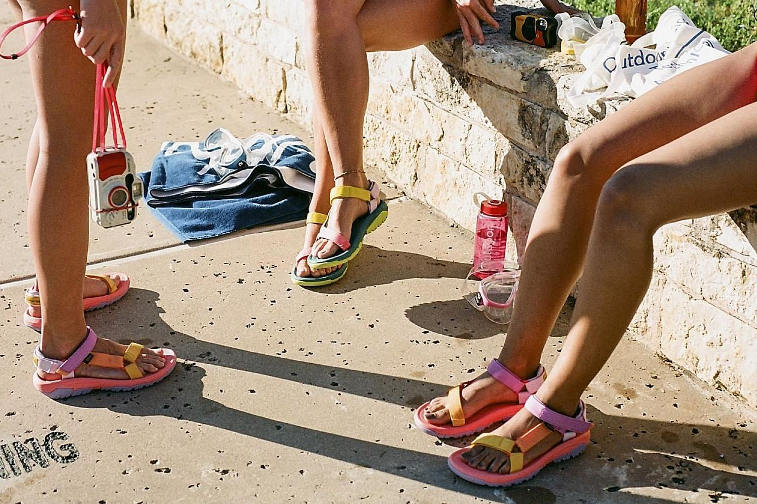 Activewear start-up Outdoor Voices teamed up with Teva for a collection of sandals marked by mismatched, colour-blocked straps.