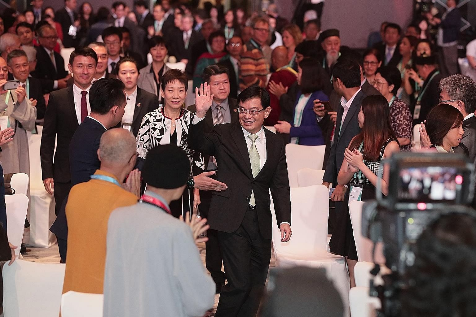 Deputy Prime Minister Heng Swee Keat arriving at the International Conference on Cohesive Societies yesterday with Minister for Culture, Community and Youth Grace Fu (beside him) and Senior Parliamentary Secretary for Culture, Community and Youth Bae