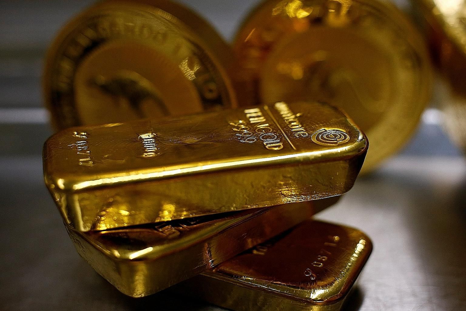 Spot gold yesterday hit its highest level since Sept 5, 2013, at US$1,395.13 an ounce, rising 4.1 per cent for the week. PHOTO: REUTERS